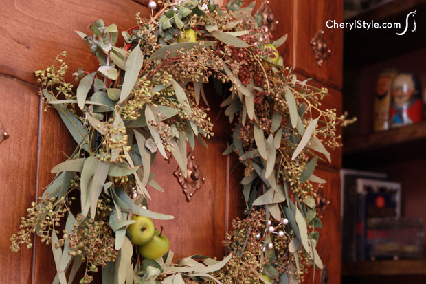 This DIY seasonal crab apple wreath makes a rustic decoration