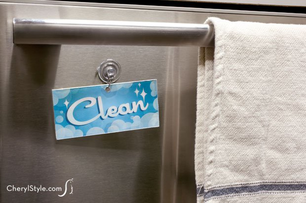 A clean/dirty dishwasher sign tells everyone when to load or unload